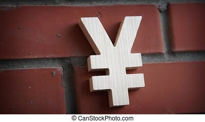 Exchange rating. Dollar and yen on brick wall - Signs of...