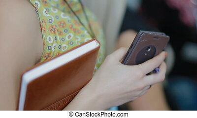 Woman hold notebook and phone in her hands - Businesswoman...