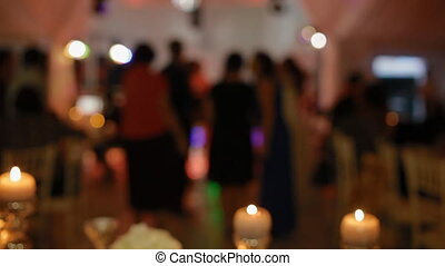 People dance on the party Party out of focus, Candle on the...