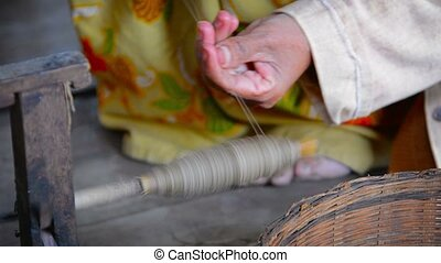 Burmese Woman Winding Thread onto a Spool to Make Yarn -...