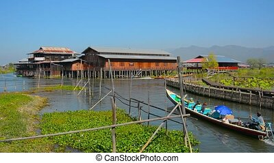 Handmade Tour Boat Navigates Canals on Inle Lake in Myanmar...