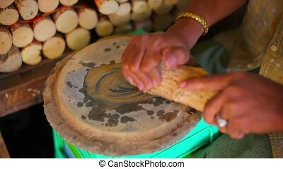 quot;Local, Burmese Woman Making Thanaka Paste by Handquot;...