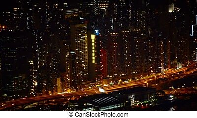 """Nighttime Cityscape with Towers, a Major Highway and a..."