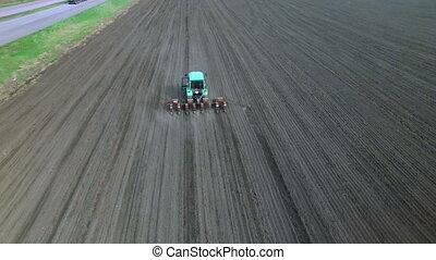 Tractor in a field making fertilizer - Tractor in a field...