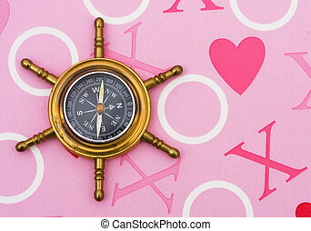Finding Love - A compass on a heart background, finding love