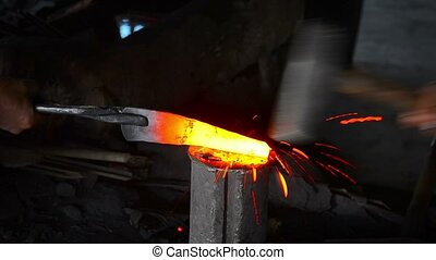 """Blacksmith Workers Shaping Steel with Traditional Tools,..."