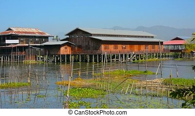 Rural Village Built over the Water of Inle Lake in Myanmar -...