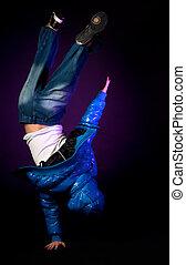 Young hip-hop dancer performing acrobatics.
