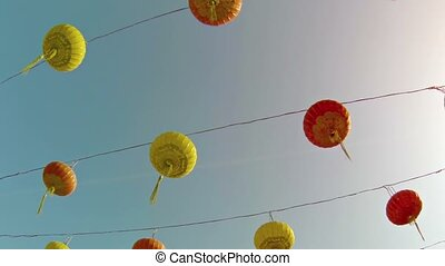 Traditional Yellow and Red Chinese Paper Lanterns outside a...