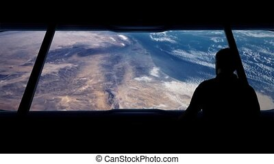 Astronaut Looks Out At Earth - Man walks over and looks at...