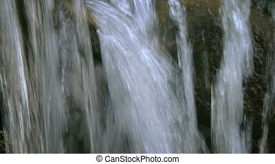 """""""Tourist Running his Hands under a Natural Waterfall, with Sound"""""""