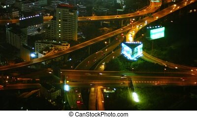 """Busy, Multilevel Highway Junction at Night"""