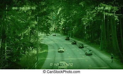 CCTV Above Forest Highway - Traffic through forest area with...