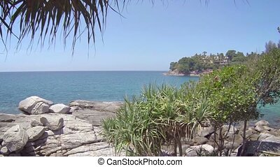 Overlooking Shot of a Rocky Tropical Beach from the Tree...