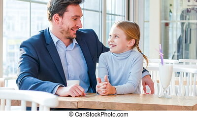 Loving father and his daughter sitting in the cafe