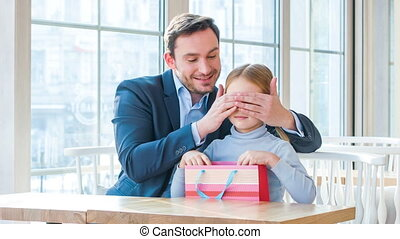 Positive father and his daughter sitting in the cafe