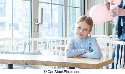 Little girl and his father resting in the cafe