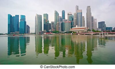 Singapores Dramatic Skyline Reflected in the River -...