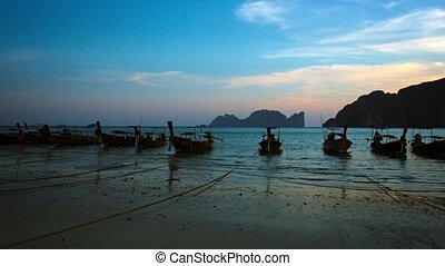 Longtail Boats Tied on a Tropical Beach at Sunset - Long row...