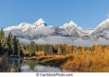Tetons in Autumn - the snow capped tetons in fall landscape