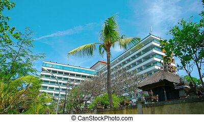 Contemporary Resort Hotel with Gentle Breeze Stirring Trees...
