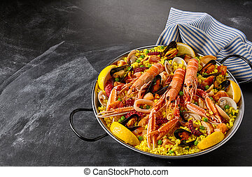 Colorful Spanish Seafood Paella with Langostino - Close Up...