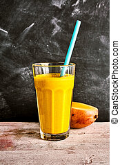 Tasty summer smoothie of fresh mango and yogurt