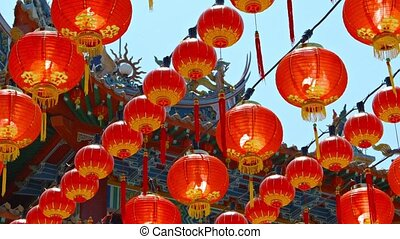 Rows of Chinese Paper Lanterns Hanging outside a Buddhist...