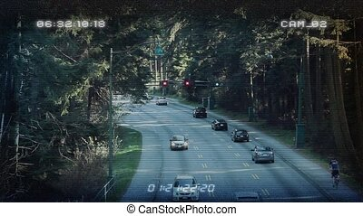 CCTV From Above Forest Highway - Traffic through forest area...