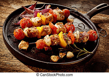 Frying pan filled with kebabs - Close up of single round...