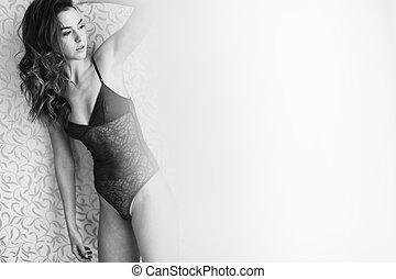 Woman posing in underwear