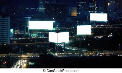 Night City With Blank Billboards - Sprawling cityscape with...