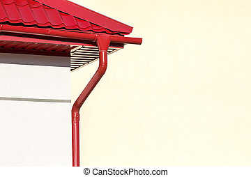 red roof with rain gutter - corner of a house with gutter...