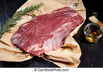 Lean raw flank steak for roasting or grilling - Portion of...