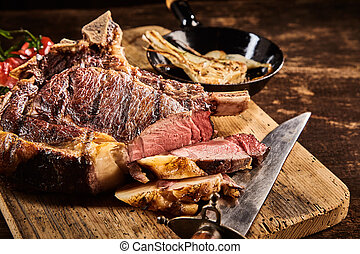 Tender medium rare steak with knife
