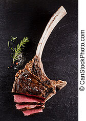 Beef tomahawk rib tip cooked rare and sliced - Close up top...