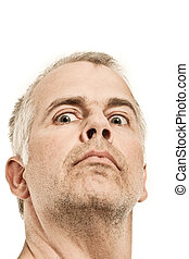 Man with crazy expression - Unshaven man with crazy...