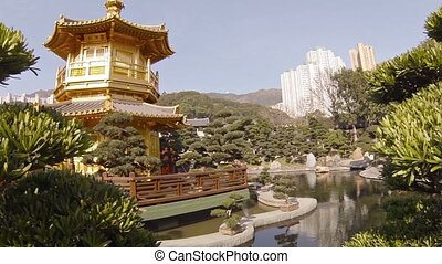Pagoda, Gardens and Pond of Chi Lin Nunnery in Hong Kong. -...