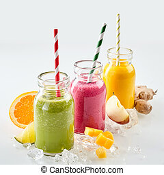 Three of fruit smoothies on ice - Row three jars of apple,...