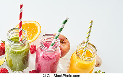 Fruit smoothie drinks with copy space - Angled row of apple,...