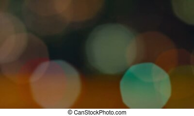 Bokeh Effect Drifting into Focus on Night Time Cityscape -...