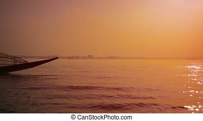 Burmese Fisherman Piloting his Boat in the Dawn Light -...