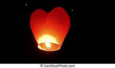 Asian Flying Lantern Ascending into the Night Sky. FullHD...