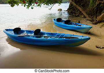 Two canoes on the beach in Jamaica