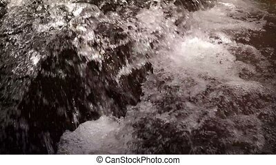 Refreshing Waterfall Cascades into Foamy Pool. Video...