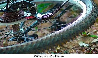 """Wheel of Overturned Bicycle Spinning Freely, then Stopped. FullHD video"""