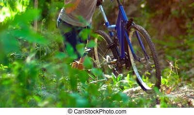Legs and Feet of Cyclist Pushing Mountain Bike Uphill. Video...