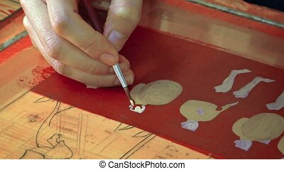 Cambodian Painter Creating a Traditional Style Work of Art....