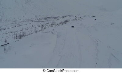Car On The Snowy Hills - Aerial view of the stray car on...