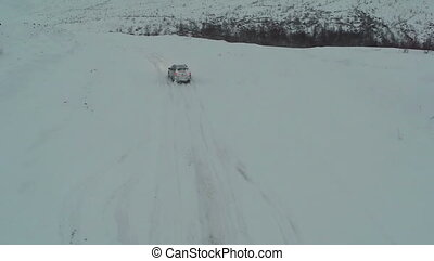 Driving On Winter Snowy Road - Aerial shot of the driving on...